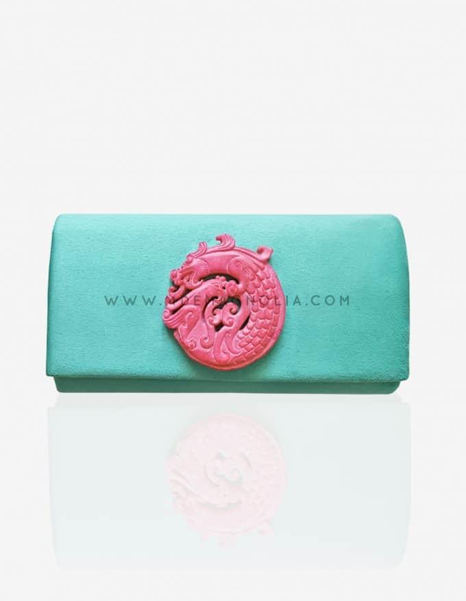 bolso aguamarina con piedra rosa