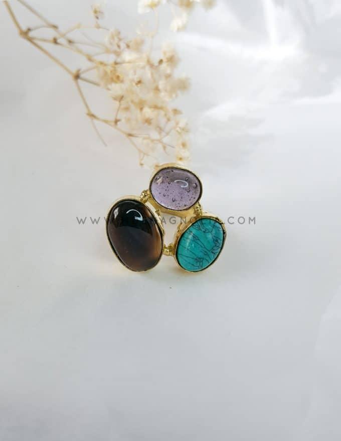 anillo lila y turquesa